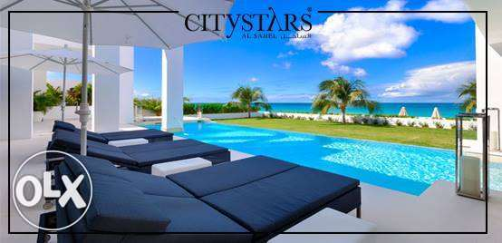 Twin house for sale in city stars north coast