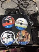 play station 4 + camera + 3 controllers + 4 games