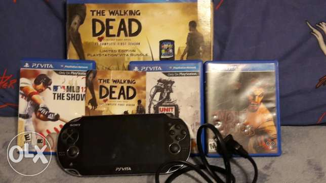 Psvita with 5 games with original charger and box and 4gb memory card