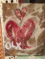 Heart painted on canvass over wooden frame