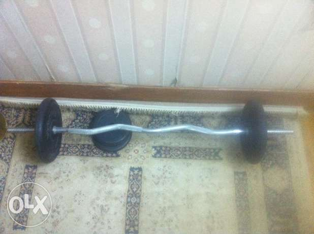 Z bar 260EGP ,two 2.5 &10 kg weights. 8 EGP per kg.