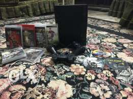 PlayStation play station 3 super slim with games and 3 controls
