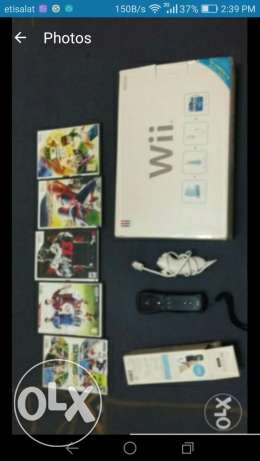 Wii console with 5 cds