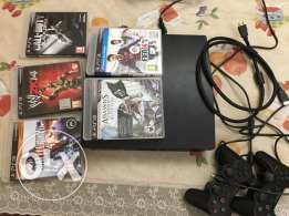 PS3 with 2 Controllers and 5 Games