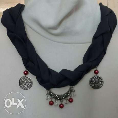 Gray scarf with silver red accessories