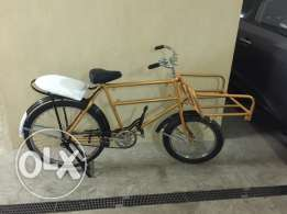 Gold bicycle with front and back seats