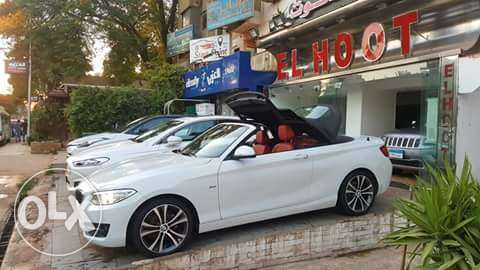 ر BMW 218 cabriolet ر White × red leather ر 10 KM