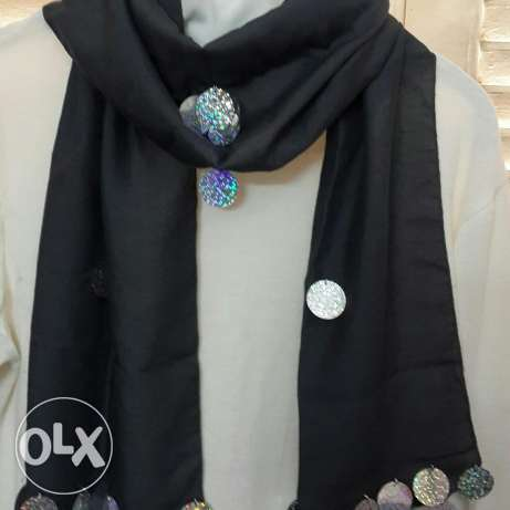 Gray scarf with silver accessories