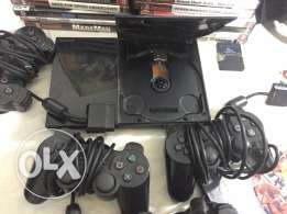 playstaion 2 in a good condition with 30 cd and tow steering wheels