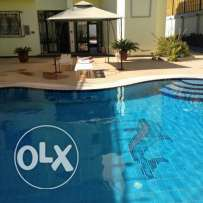 Half villa In Mubarak 7, 1st stage. Swimming pool, sea view, 900 sqm