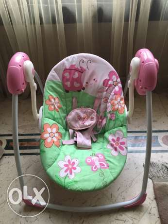 Used baby swing in excellent condition with its box