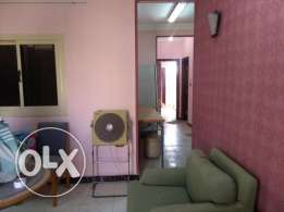 For sale spacious two-bedroom apartment in El Kawther .360000 LE