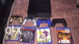 PlayStation 4 with 4 Controllers and 7 Games