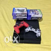 PlayStation 4 - 1TB - 2 DualShock Controllers - \w 12 Games CDs