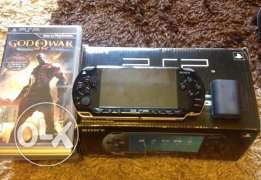 PSP for sale with (10 CD's - Camera - Bag)