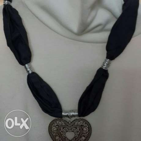 Gray scarf with silver heart accessories