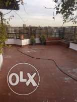 Beautiful unfurnished penthouse at mohandsin wz big roof terrace