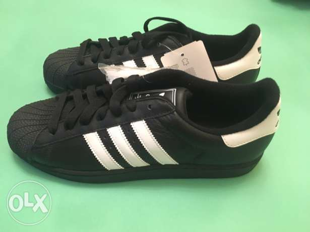 Original Adidas superstar with box size 42 2/3 and serial code