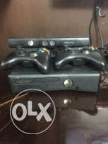 Xbox 360 with two remotes