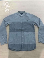 Original Fred Perry Men Black in White shirt.