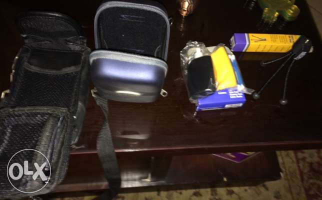 Camera Cases, Tripod, Cleaning kit