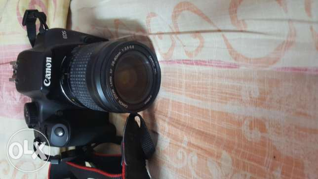 Canon 1000D with the bag and memory card 32