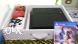 Sony PlayStation 4 Slim-1TB With Extra2 Controller and Fifa 16 WWE2K15