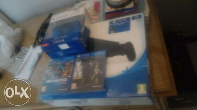 PS 4 Slim 1 TB with extra controller and 2 games whatsapp me if int.