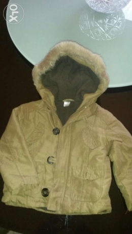 Max coat for boys from 6 month to 12 with fur on top excellent conditi