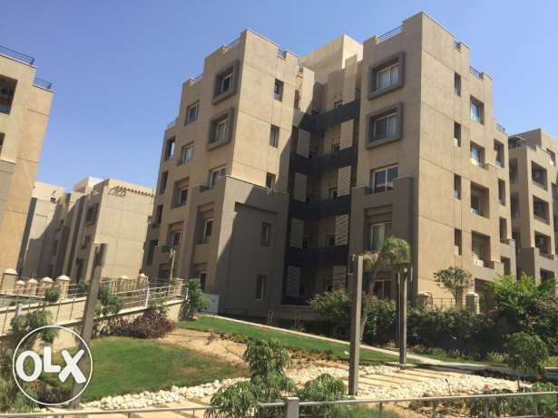 Apartment for rent in the Village garden view القاهرة الجديدة -  2