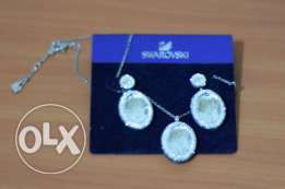 swarovski set earning and neckless طقم حلق و عقد