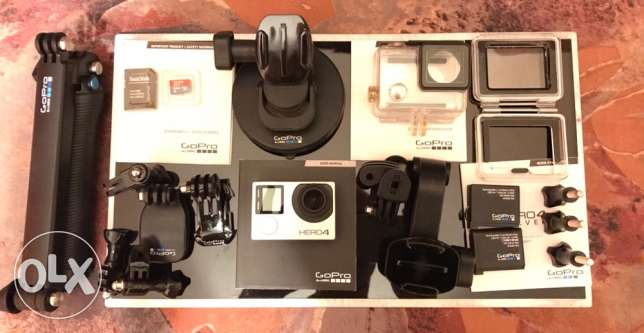 GoPro Hero 4 silver (with All Original mounts, accessories,housings )