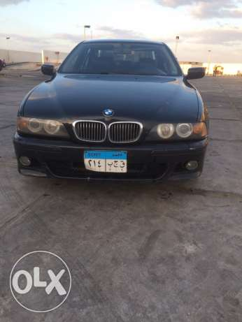 BMW E39 523i model 1998 blacl