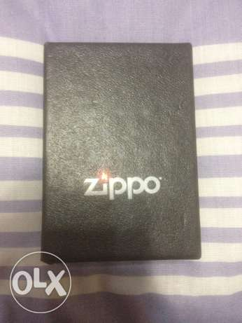 Gold Colored Zippo With A Stripper Logo For Sale المنيل -  1