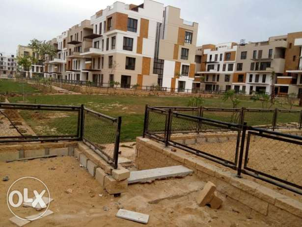Ground apartment in West town Sodic for sale prime location 190 sqm الشيخ زايد -  1