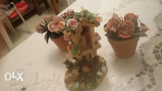 Handmade clay flower pots and bird house