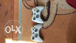 X box 360 with 5 games and two joystikes