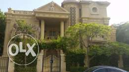 Standalone villa in Mena garden City ultra prime location 1050 sqm FF