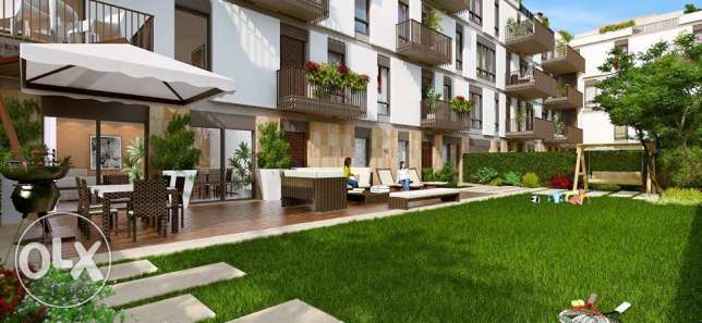 Apartment with garden For Sale in Courtyards SODIC