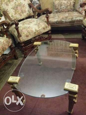 table topped with glass 8 mm ( to show the beauty of carpets) with ver
