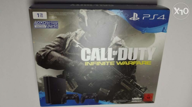 "Playstation 4 slim + 2 controllers + COD infinite warfare ""PS4 slim"" مصر الجديدة -  1"