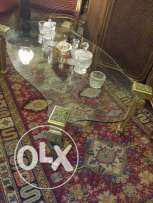 very old table topped with glass 10 mm ( to show the beauty of carpets