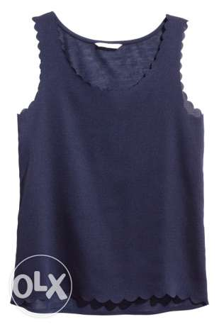 Top with scalloped edges .. Black
