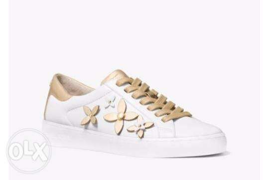 MK shoes available for immediate purchase white gold color