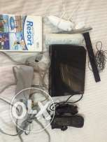 wii black with one original game and 2 controllers