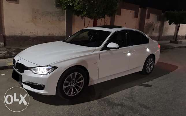 BMW 328i 2015 white x saddle brown 9000km only