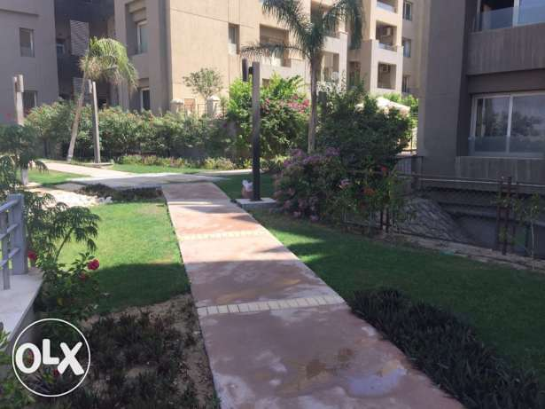 Apartment for rent in the Village garden view القاهرة الجديدة -  3