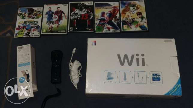 Wii and 5 CD and 1 black joystick