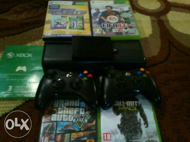 Xbox 360 with 5 games and with online code with 320 GB hard