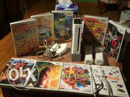 Wii console with 9 original games